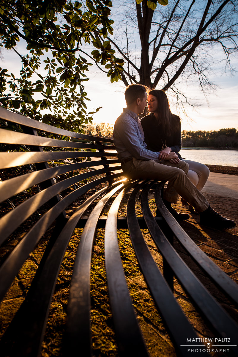 couple sitting together on bench at Furman at sunset