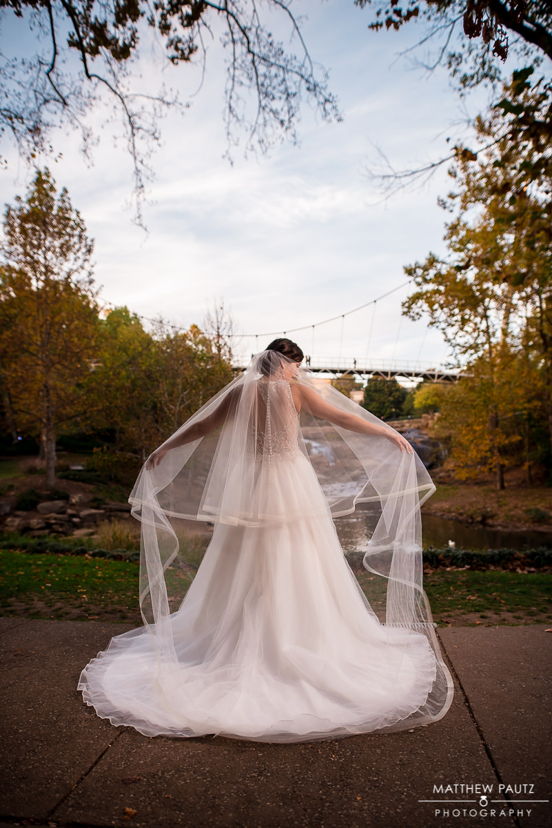 bride adjusting her veil in Falls Park