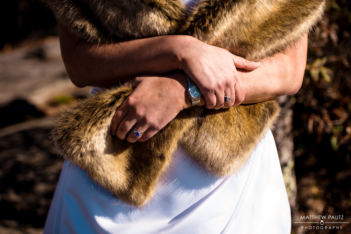 closeup of eloping bride's fur wrap