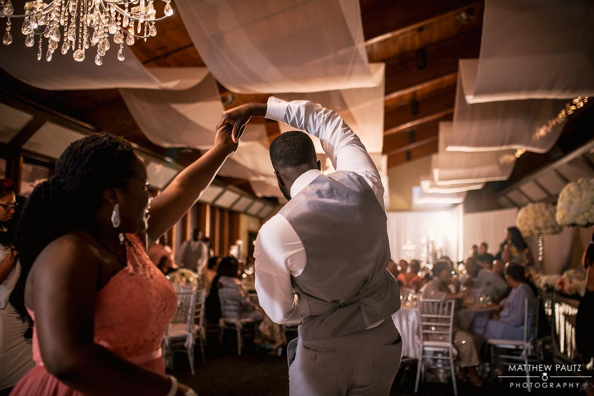 Groomsmen dancing at reception