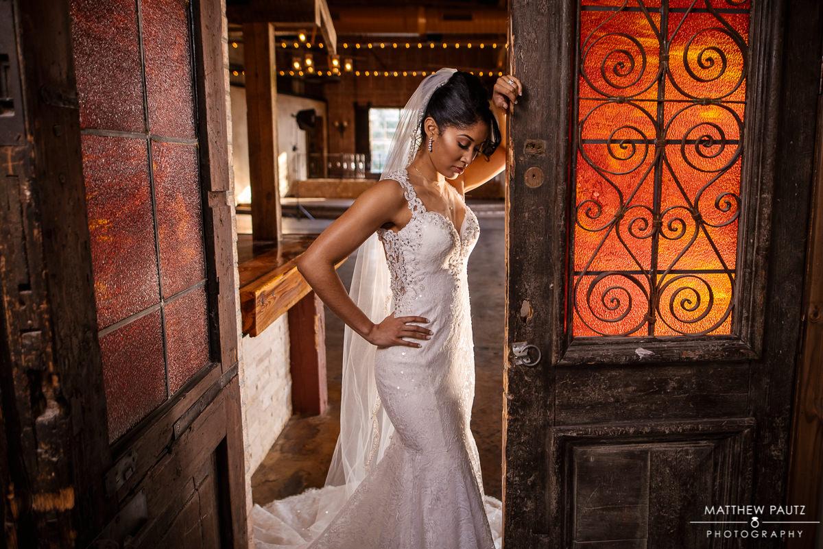 Bride posing in wedding dress in doorway at Revel in Greenville SC