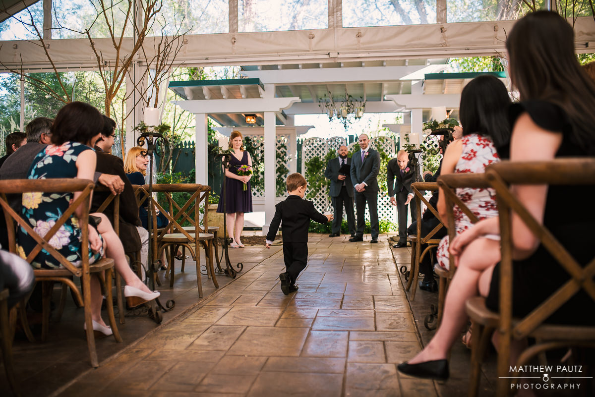 Ring Bearer walking down aisle during wedding ceremony