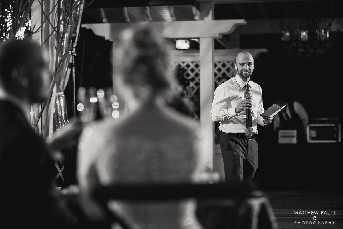 best man giving speech at wedding reception