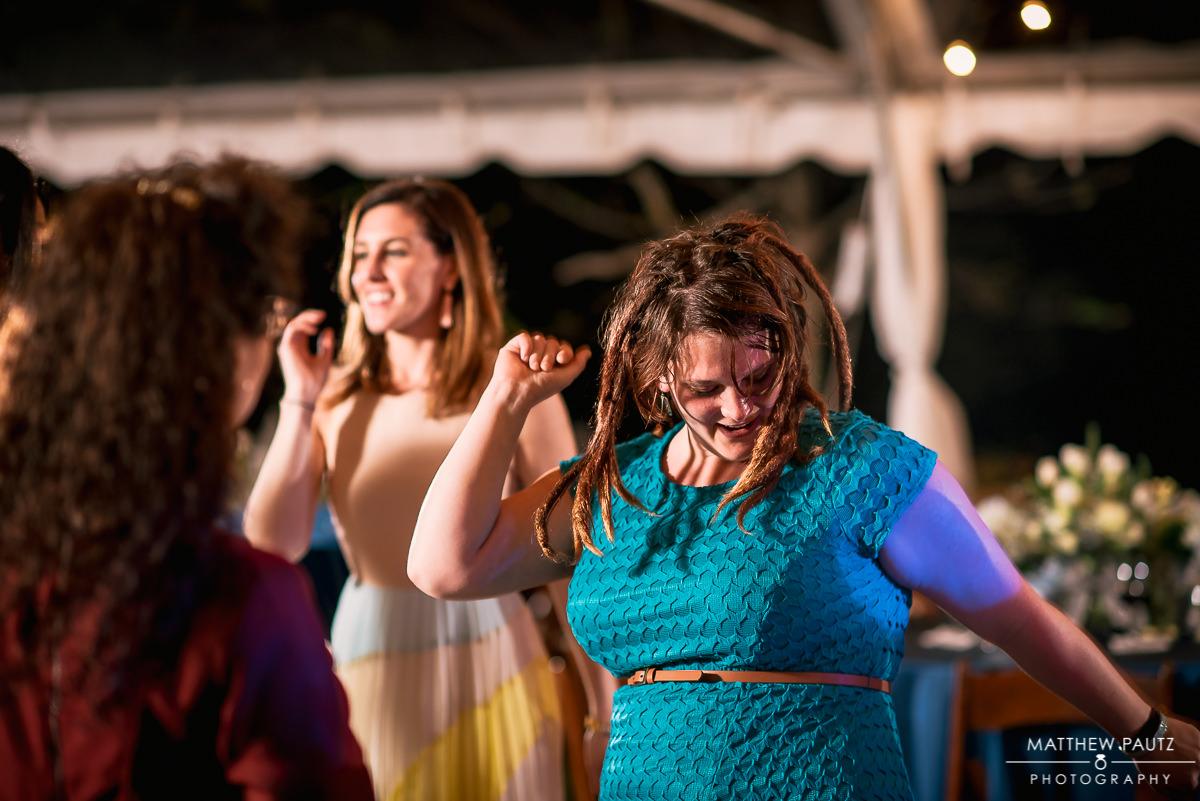 Wedding guests having fun and dancing at reception