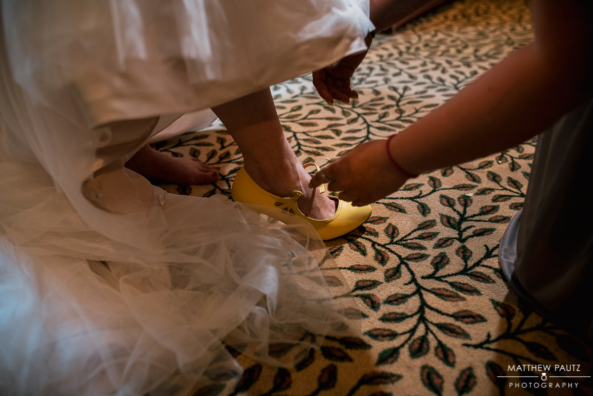 Bride with yellow wedding shoes