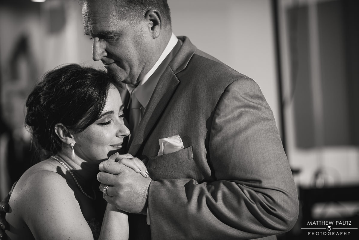 Bride dances with father at wedding reception