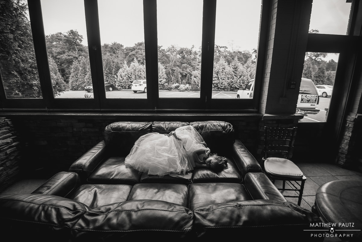 flower girl sleeping on couch after wedding ceremony