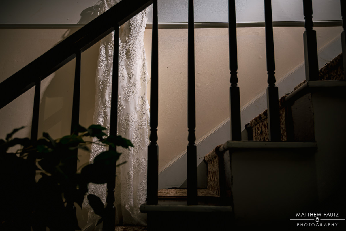 Wedding dress hanging in stairway at church