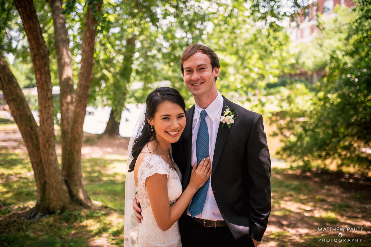 bride and groom posing in downtown Greenville Sc